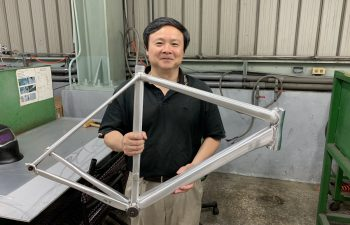 Figure 1. Prof. Xiaochun Li, founder and chief scientist of MetaLi, holding a prototype bike frame welded together with the company's proprietary AA7075 welding wire.